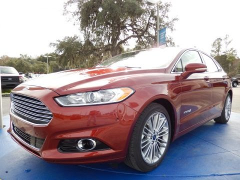 Sunset 2014 Ford Fusion Hybrid SE